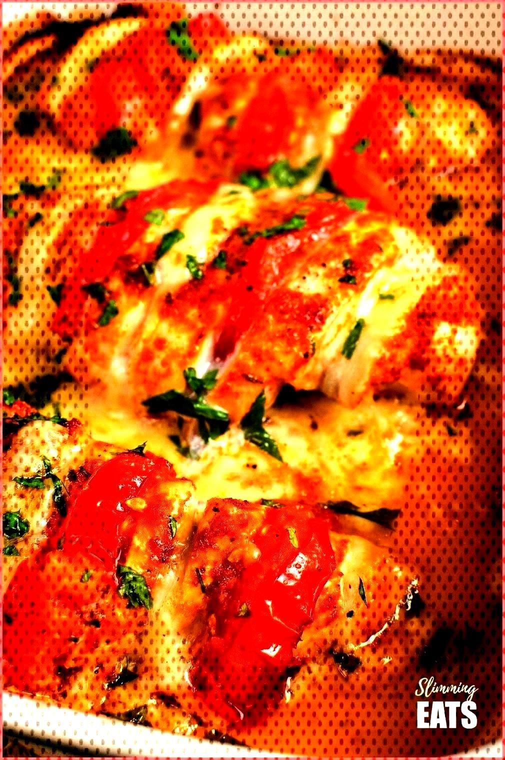 and mozzarella hasselback chicken in oven proof dish - - tomato and mozzarella hasselback chicken i