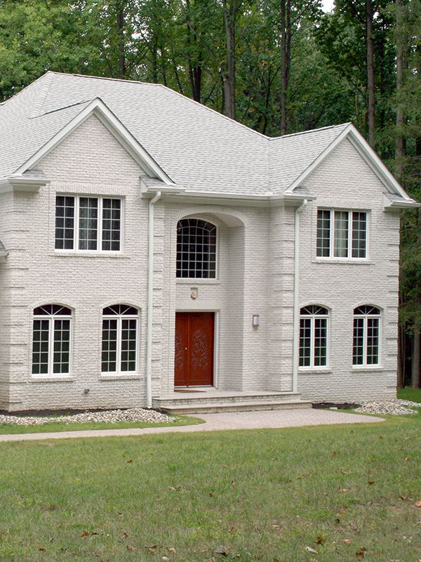This Residence Features Split Face Vintage Series Brick In Arctic White Quoin Corners And Window