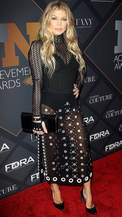 Fergie in a black grommet sheer midi dress