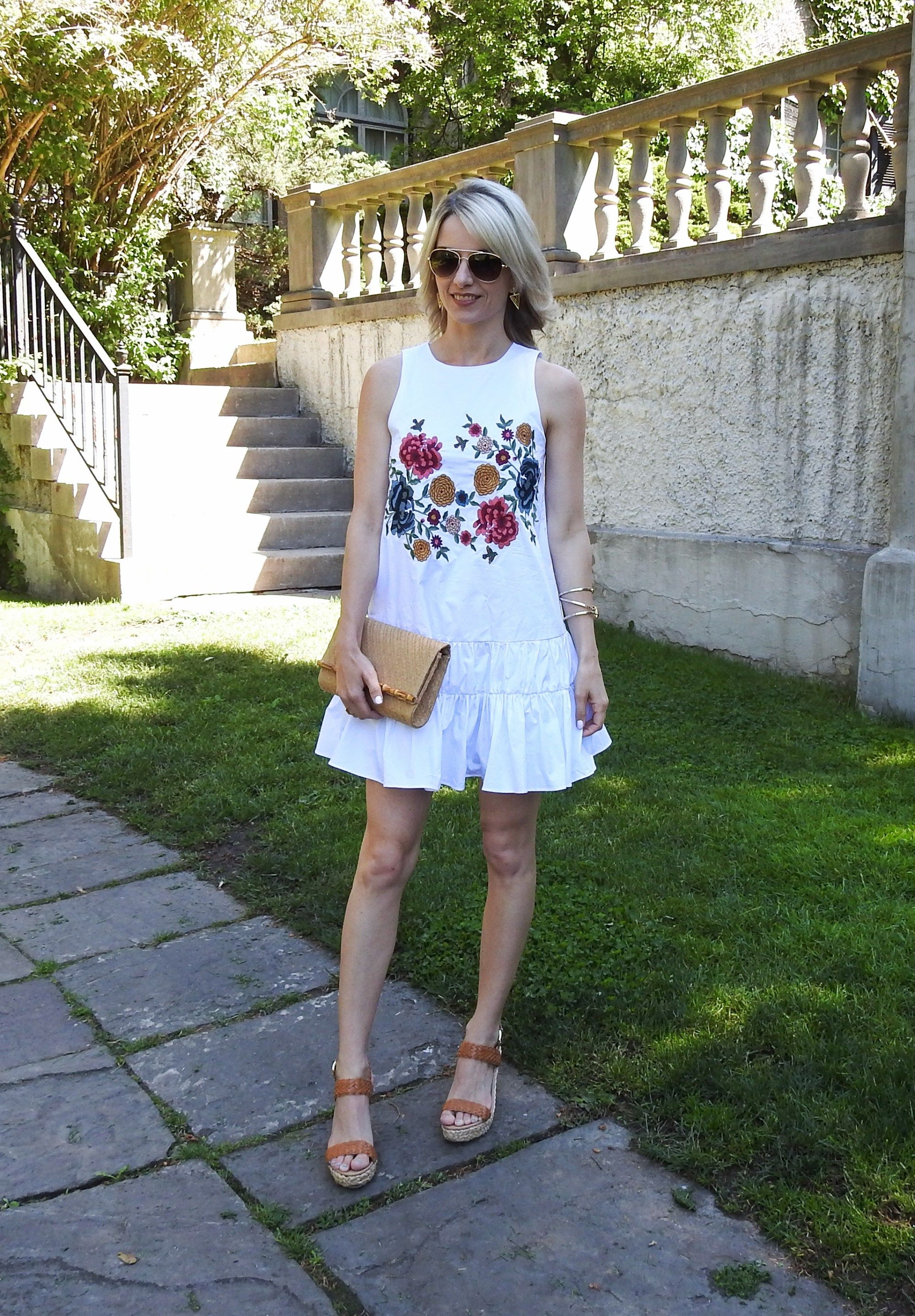 Summer dress, summer outfit, white embroidered dress with tiered skirt, wedge sandals, bamboo clutch, tiaras and heels blog