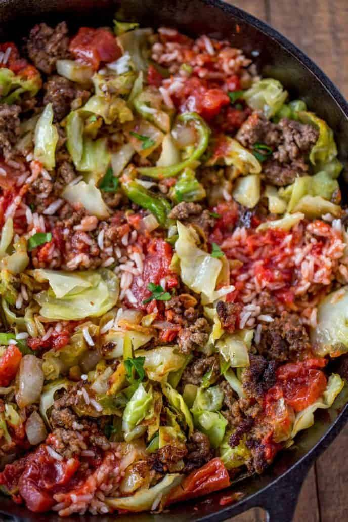 Stuffed Cabbage Casserole made with cabbage beef onions rice and a chunky tomato sauce on your stovetop in just 30 minutes made crispy in a cast iron skillet Not like gra...