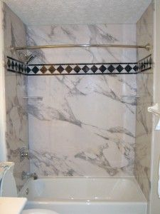 These Shower And Tub Wall Panels May Look Like Real Stone But They Are Not Using A Unique And Bathroom Shower Walls Shower Wall Panels Acrylic Shower Walls