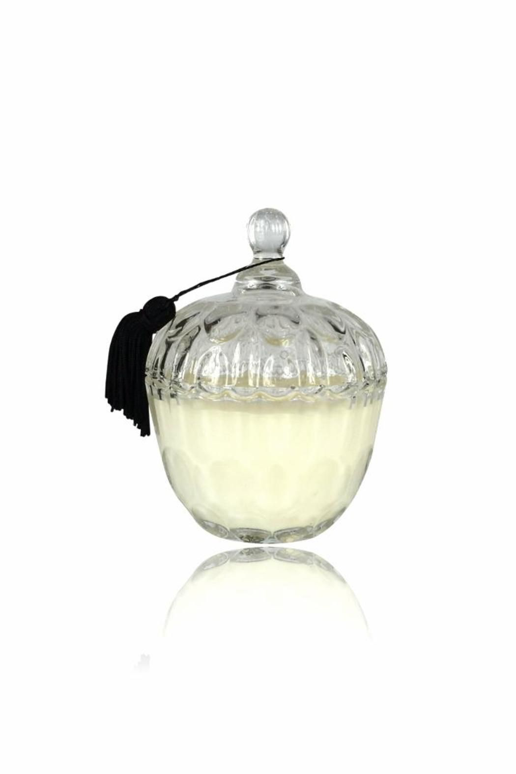 "Made from clean burning soy wax and lead free cotton wick, this curvaceous candle personifies the golden age of hollywood. It's glass scalloped base, lid, and scent dipped tassel will decadently dress your home. We encourage you to re-purpose the vessel to aptly house your trinkets and treasures. Approx. 70 - 80 hours of burn time. 10 oz. wax blend Measures: 6 inches high with lid, 2.75"" base, 4"" diameter   Persian Fig Cabochon Candle by DAVINCI. Home & Gifts - Home Decor - Candles & Scents…"