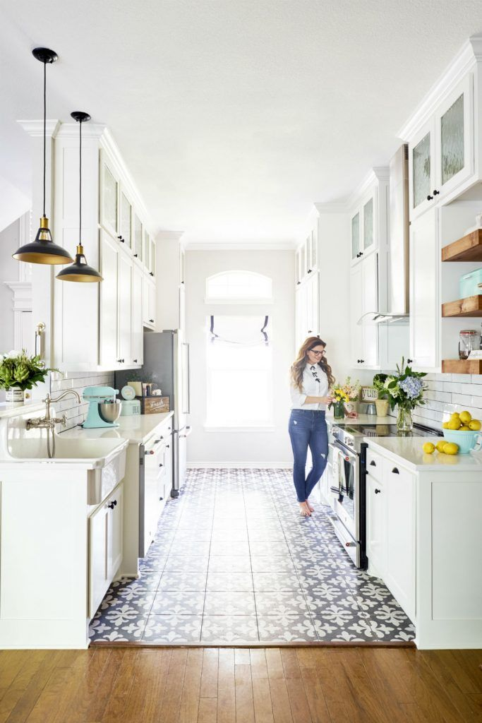 Not every kitchen has the open concept with an island but that doesn't mean it can't still be beautiful. Here are some tips to make your galley kitchen stand out with a clean, fresh look!