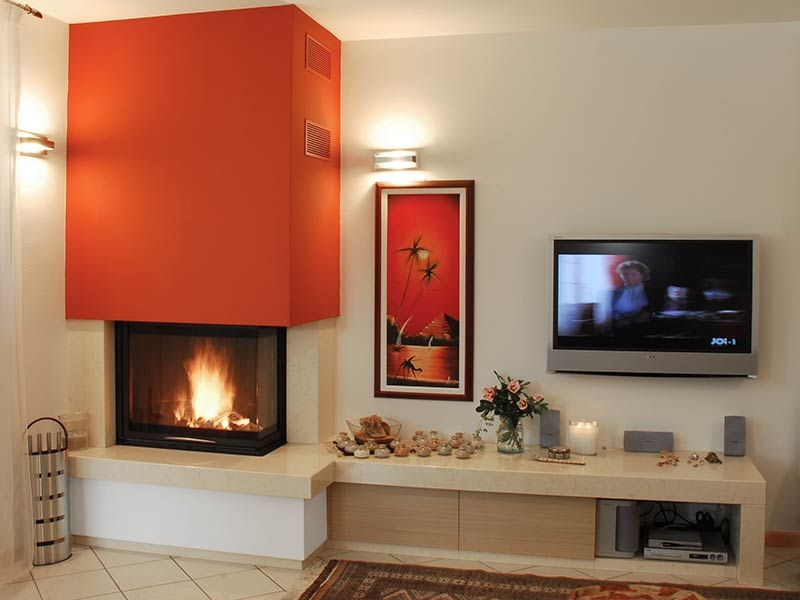 Caminetto moderno ad angolo con panca stoves and for Salotti moderni con camino