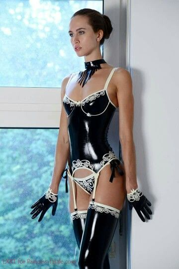 Black Latex Lingerie With Intricate White Lace Around The Trim