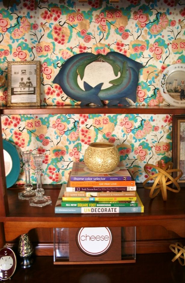 This dolphin mirror is from my childhood room - and I still love it! Now it takes a place in our china cabinet. | www.rappsodyinrooms.com