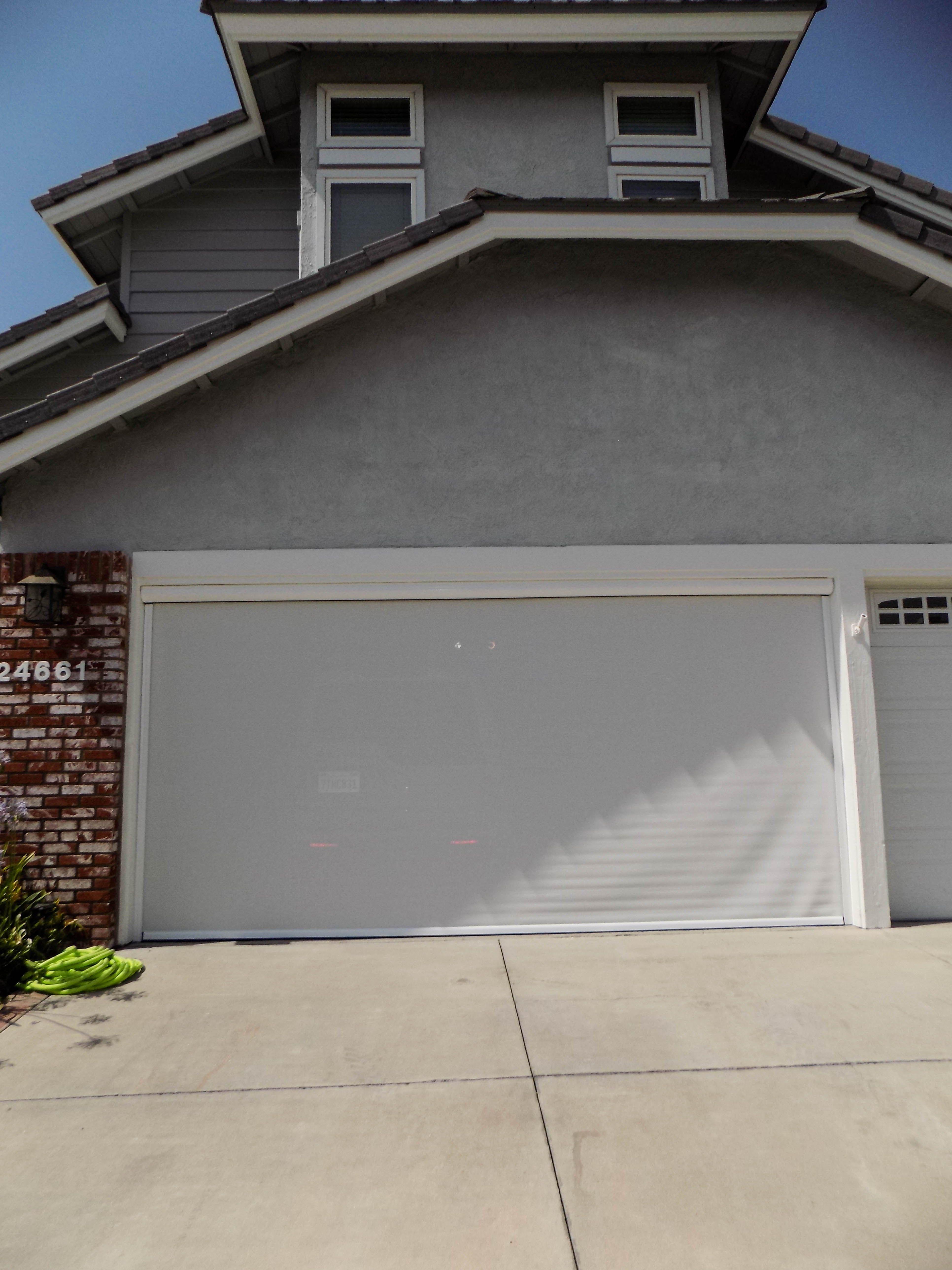 We Installed A Motorized Power Screen On A Garage Door In Laguna Hills California In Orange County F Garage Doors Garage Door Design Garage Door Installation