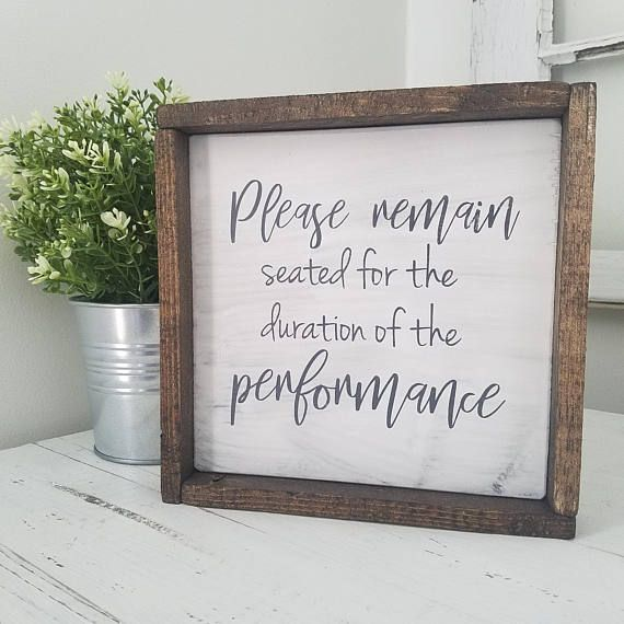 Photo of Farmhouse Bathroom Sign Please Remain Seated For The Duration Of The Performance