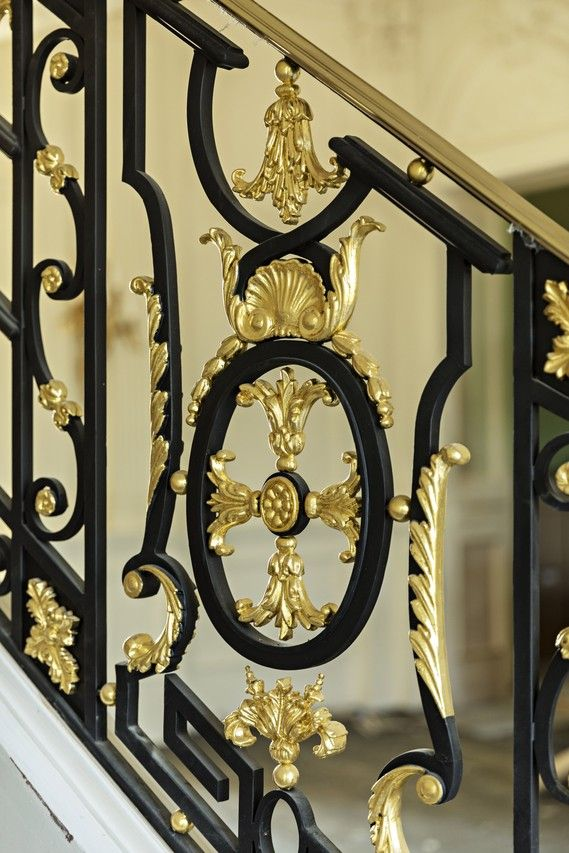 On the staircase in the foyer, the cast-iron and gold-leaf banister is a replica of one found at Le Petit Trianon.