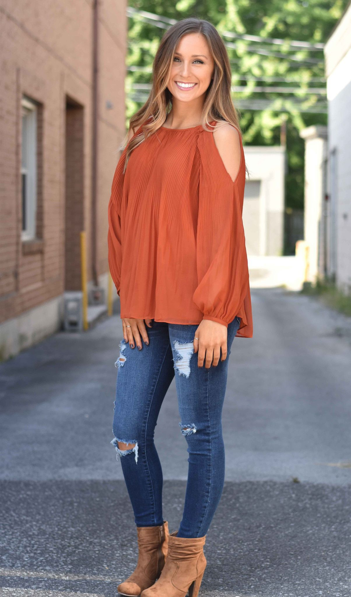go all out in this rust cold shoulder top! the perfect color and