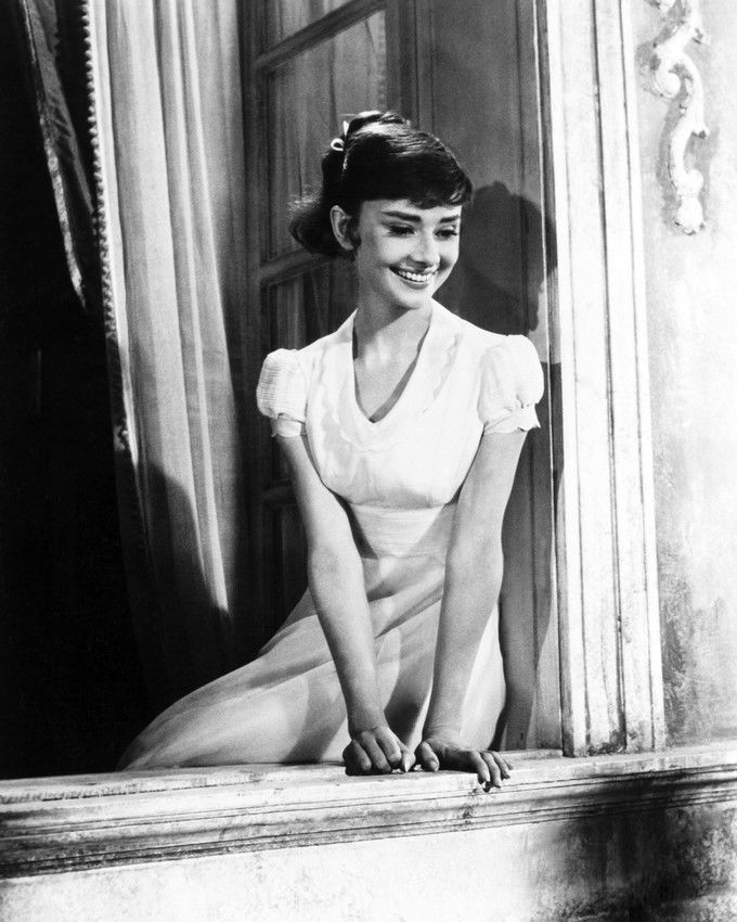 Audrey Hepburn Roman Holiday 16x20 Poster sitting on window ledge