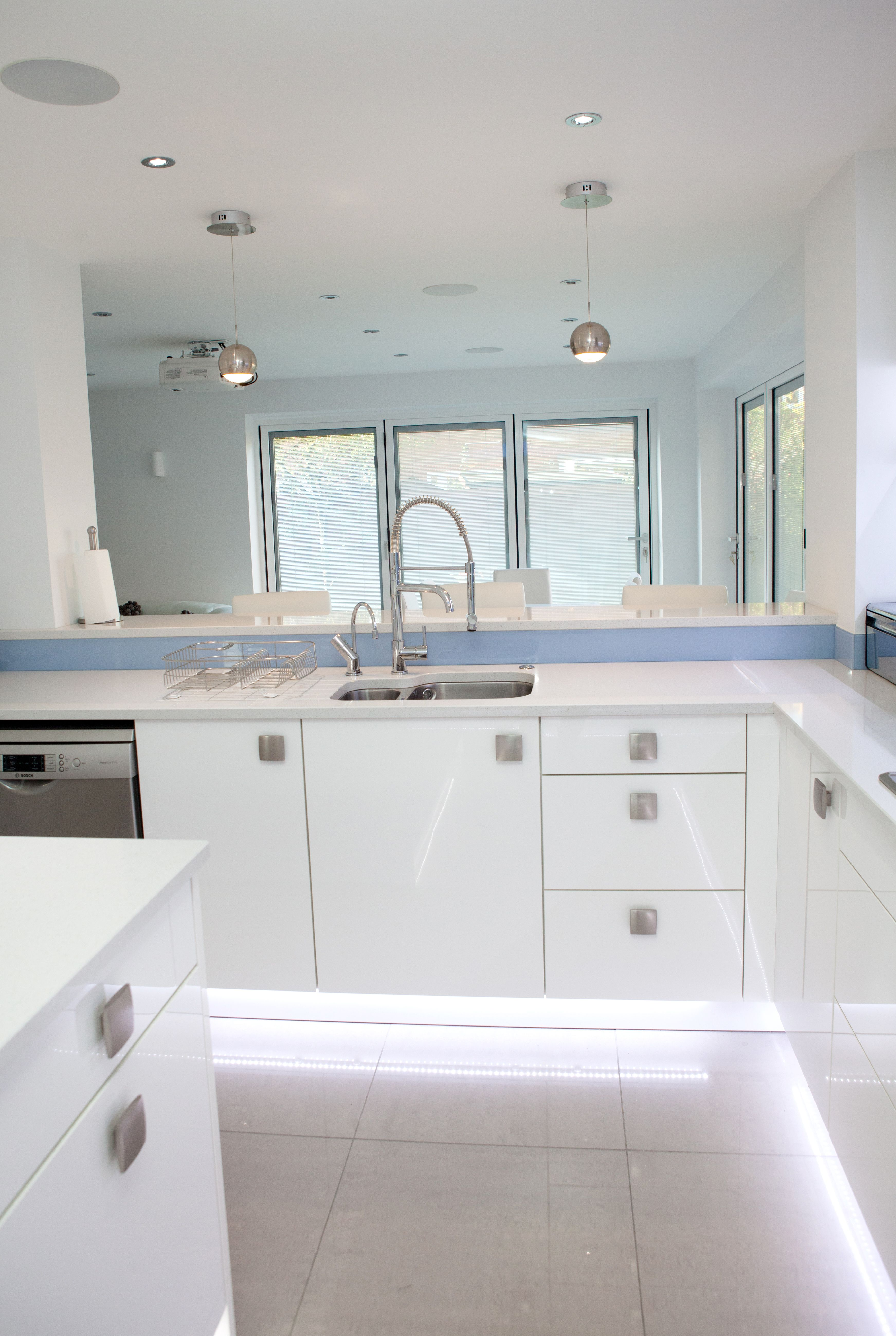 Nolte Kitchens | Glass splashbacks, Kitchens and White gloss kitchen