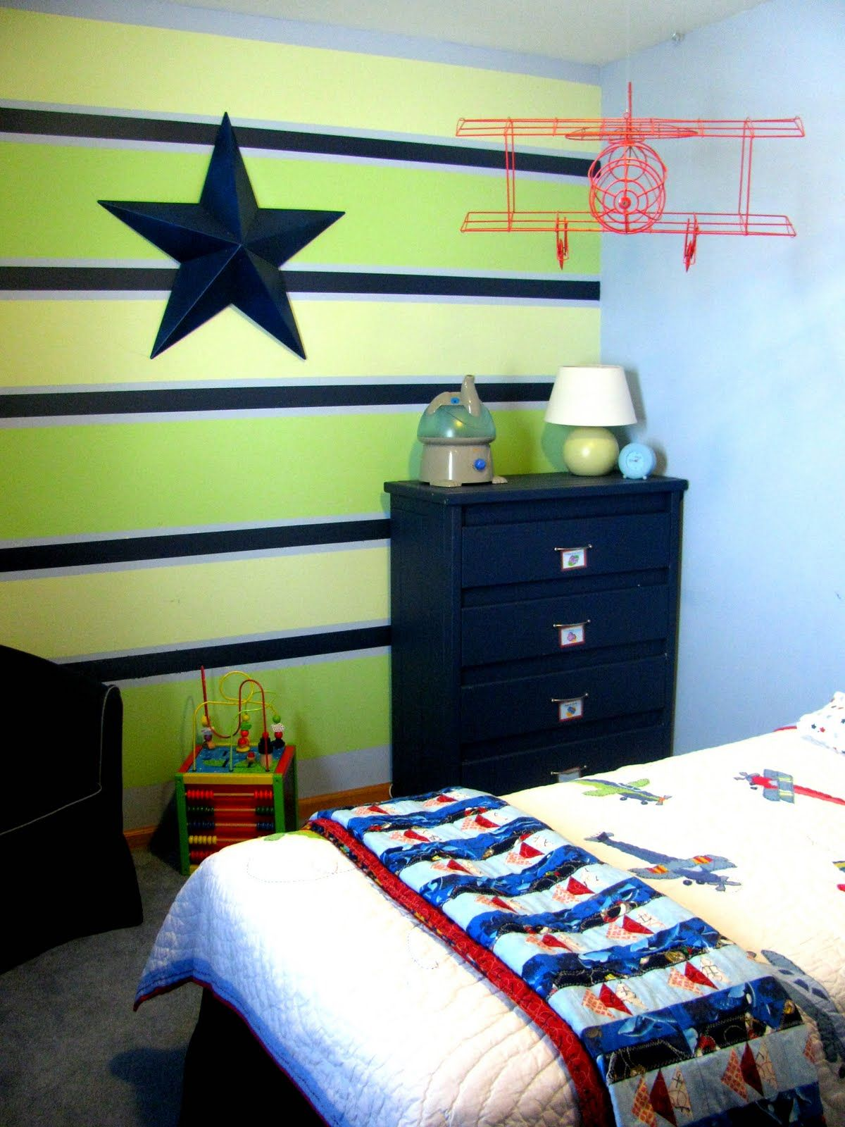 Love the colors on that striped wall boys room design for Painting stripes on walls in kids room