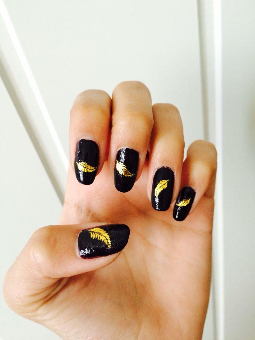 My nails #blacknailpolish #feather