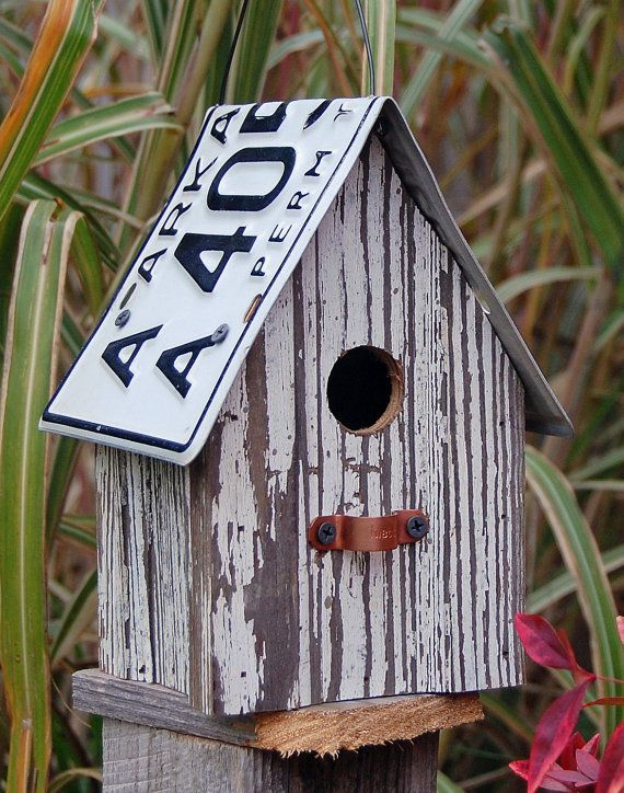 Birdhouse made from recycled wood and an old license plate from etsy.com.