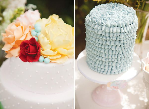 LOVE that simple white polka dot cake with flowers on top. via HWTM