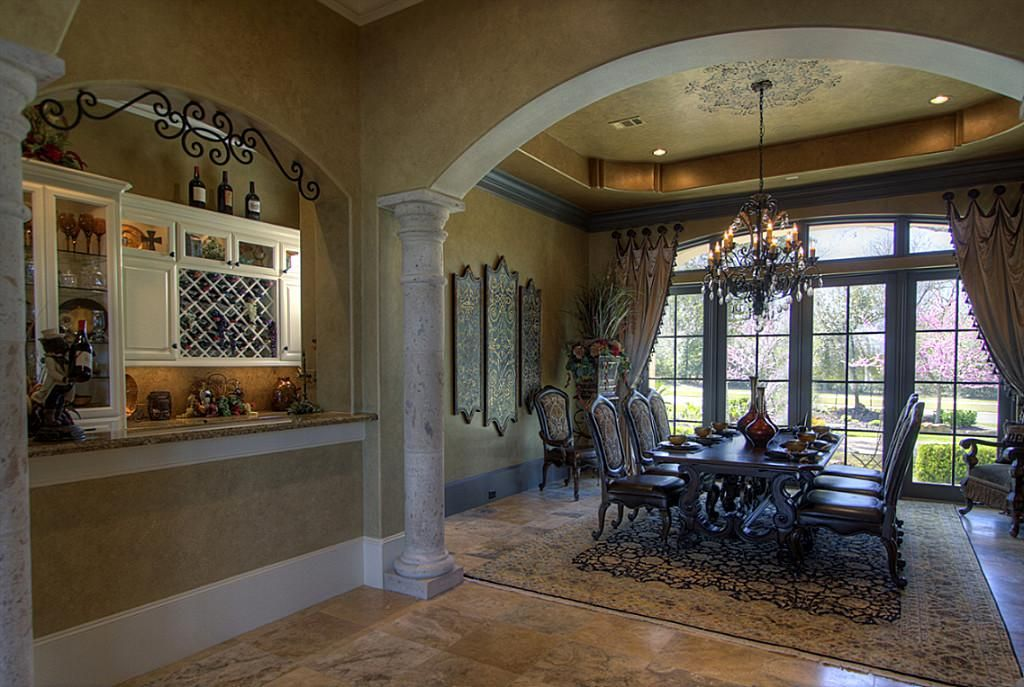formal dining rooms with columns. wine grotto and formal dining room featuring wrought iron, cantera stone columns arches. rooms with