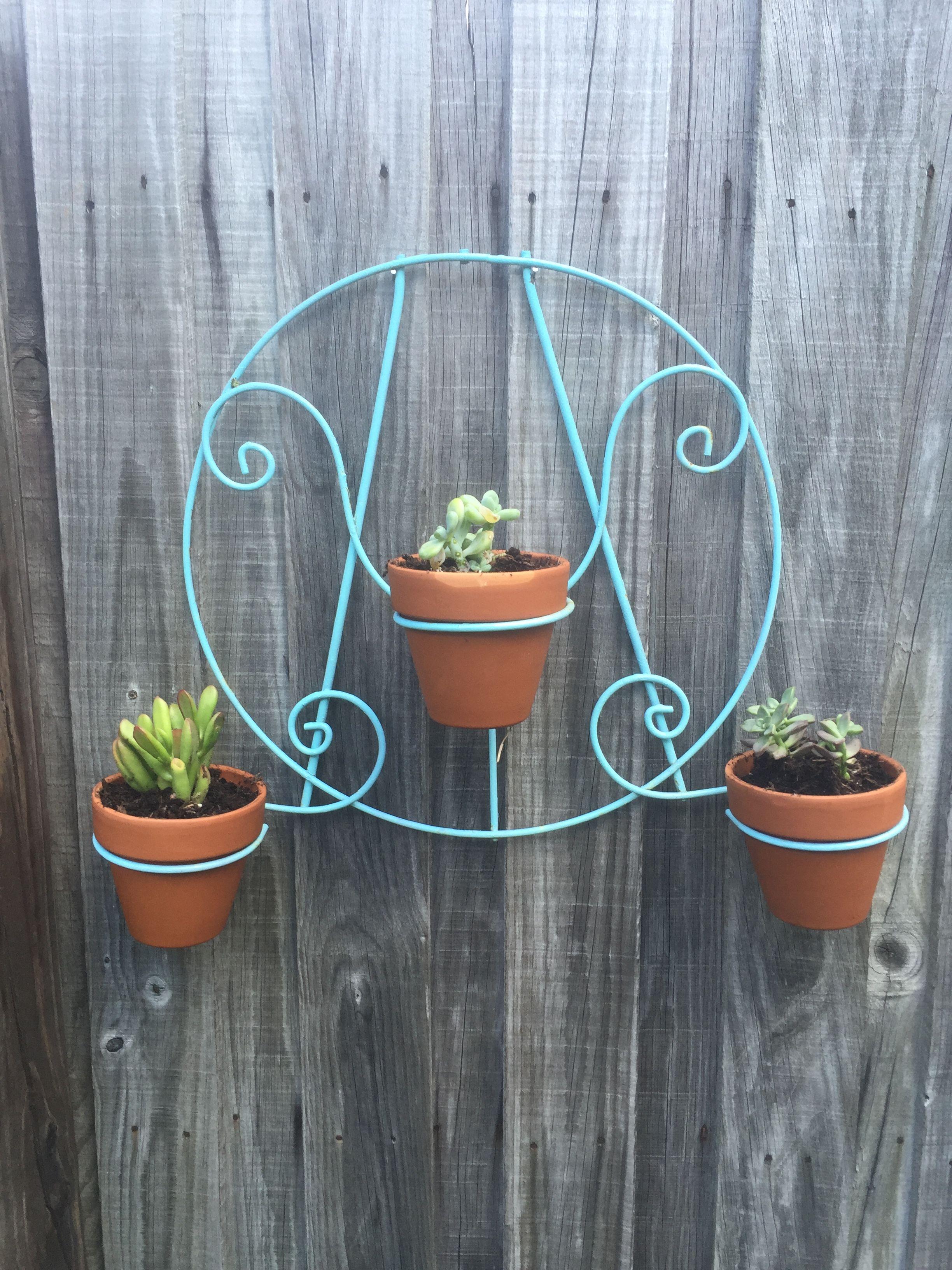 Iron artwork turned planter