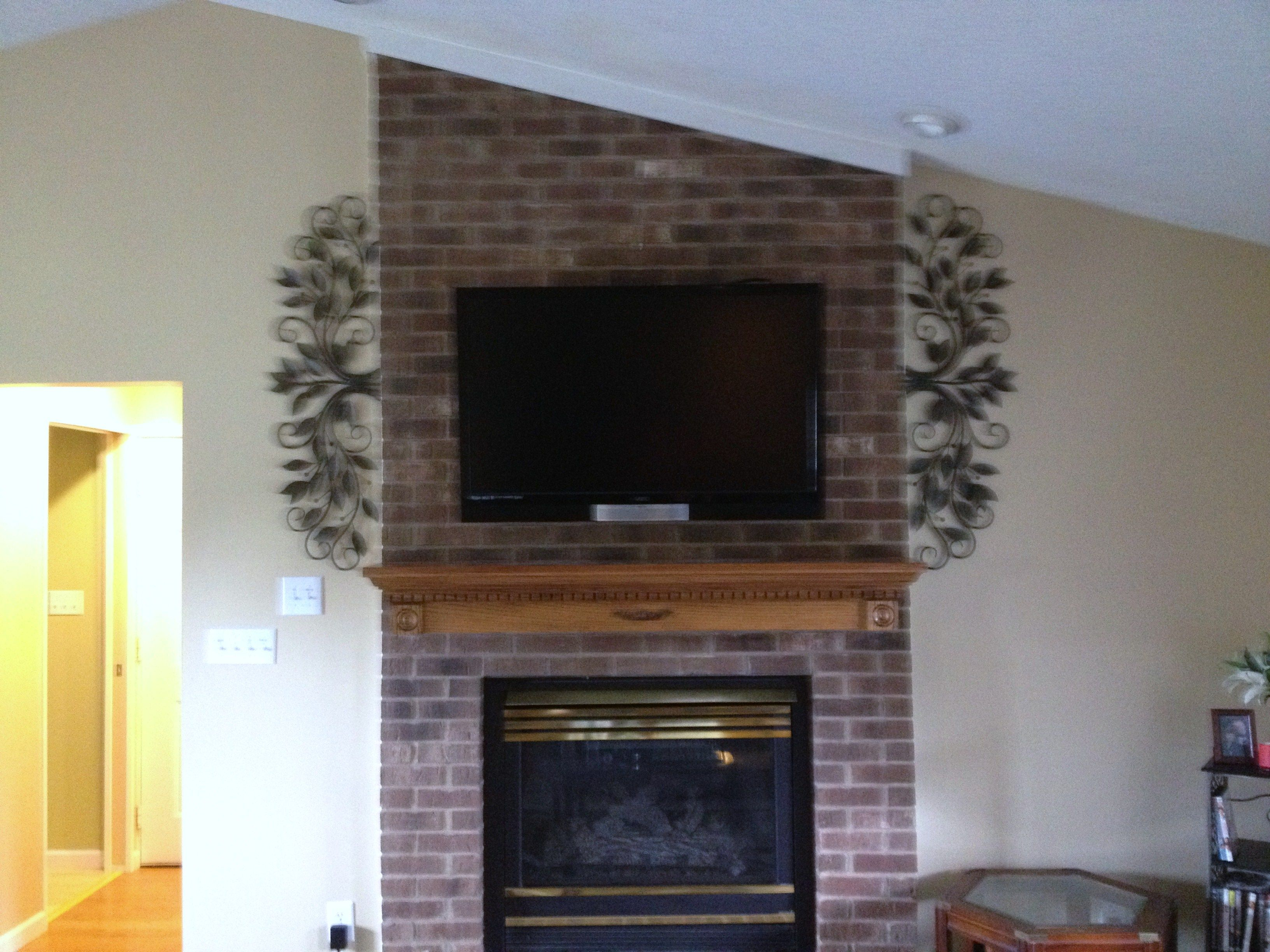 Tv Mounting Over A Fireplace With Wires Concealed In The