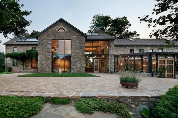 Modern redesign of old country home with antique stone for Modern country house