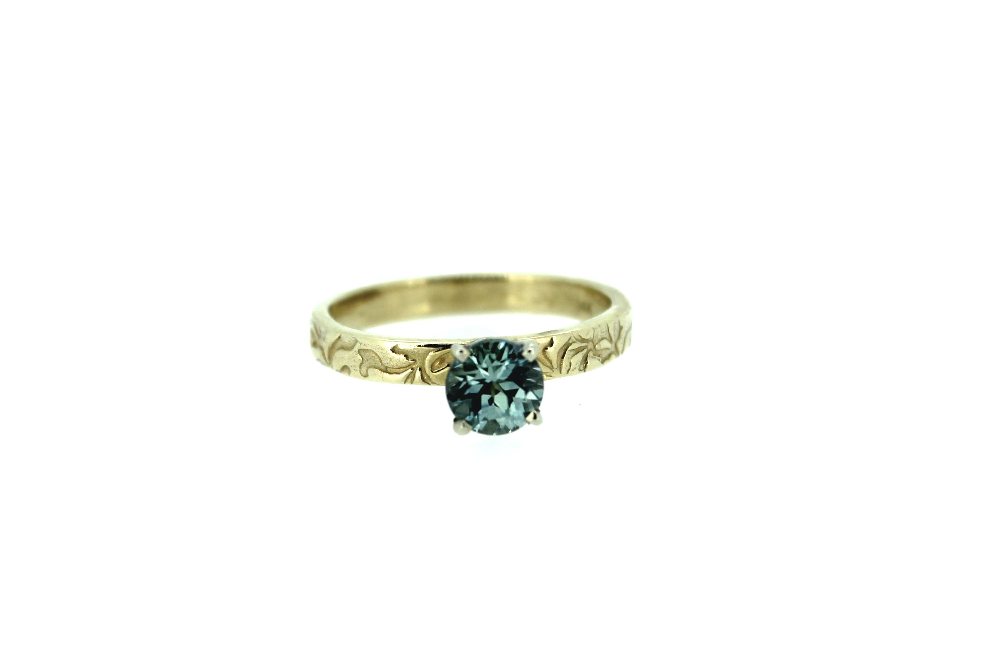 Montana sapphire engagement ring . My signature vines are engraved on the 14k yellow gold band . handcrafted by peaces of indigo