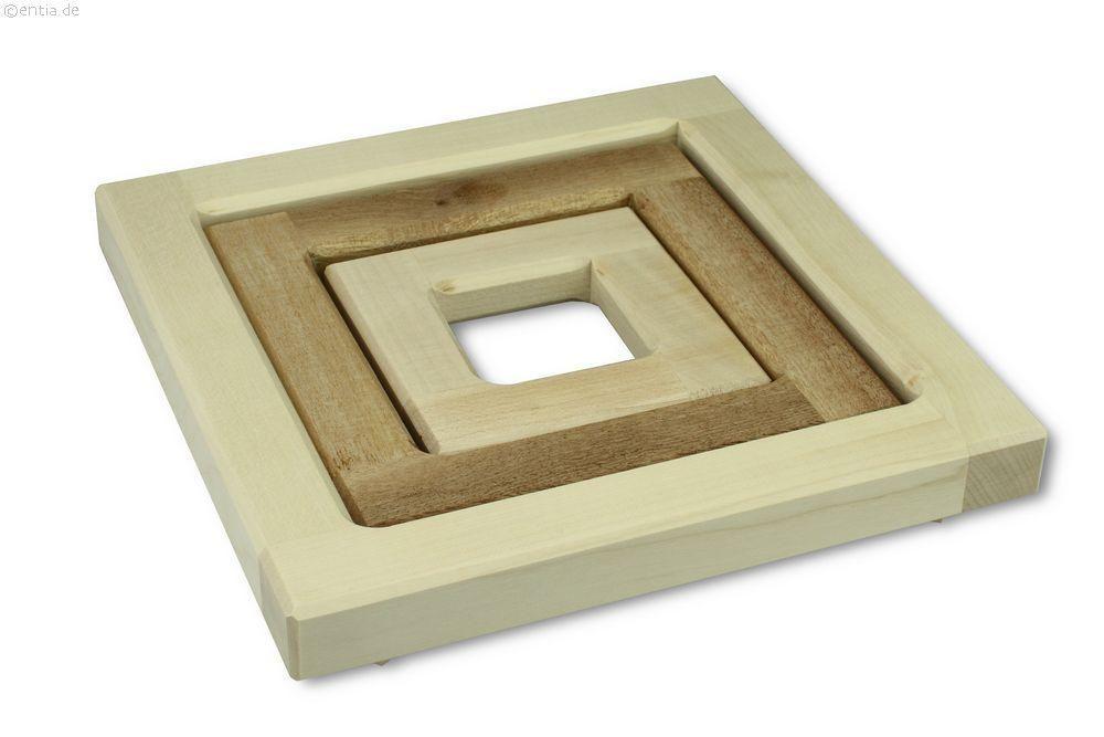 Topfuntersetzer aus drei einzelnen Holzteilen, die auch separat verwendet werden können.