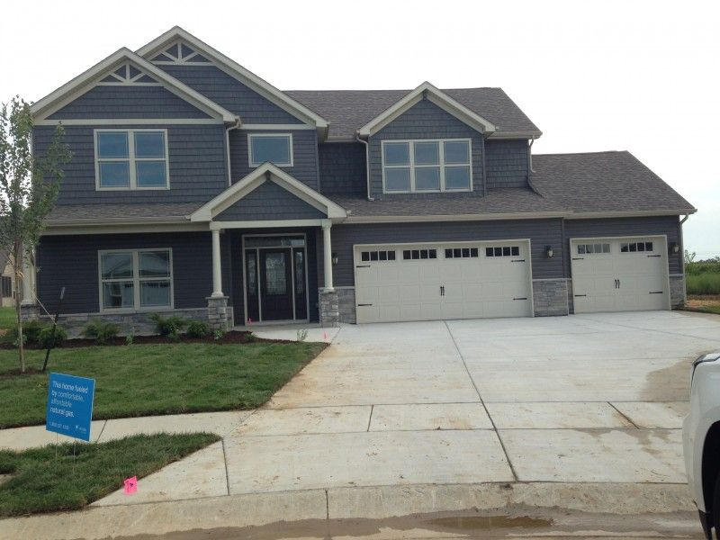 Slate Blue Siding And Shakers White Trim And Garage Door Grey Brick Charcoal Or Black Roof And A Red Door Blue Siding Brick Siding Blue House