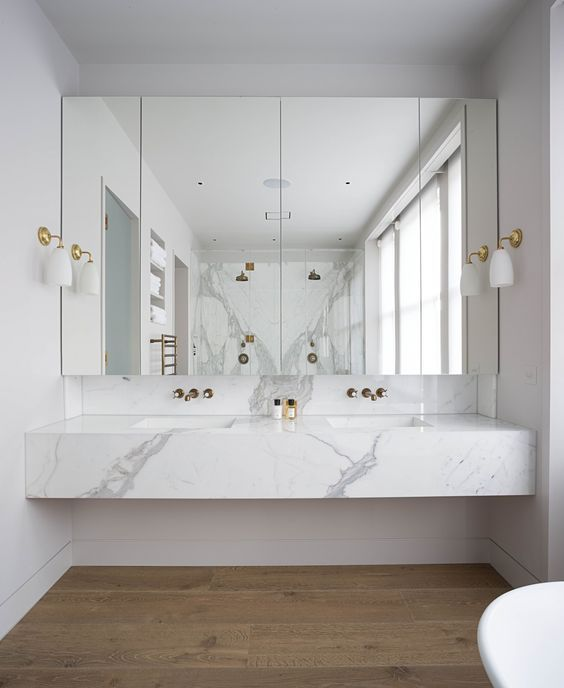 Photo On a floating marble vanity top gives a feeling of luxury to the space