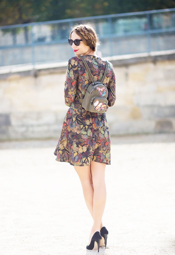A flirty butterfly romper and black pumps is a perfect look for this fall.