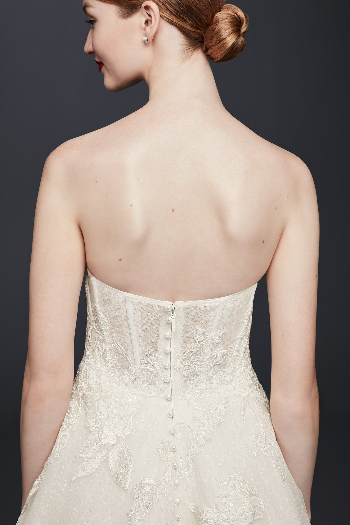 We love the special added detail of the pearl buttons on this sheer