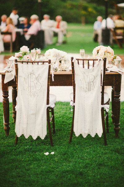 embroidered Mr. and Mrs. chair covers from BHLDN http://www.bhldn.com/ Photography by Emily Blake / emilylblake.com, Floral Design by Rolling Hills Flower Mart / rollinghillsflowermart.com/