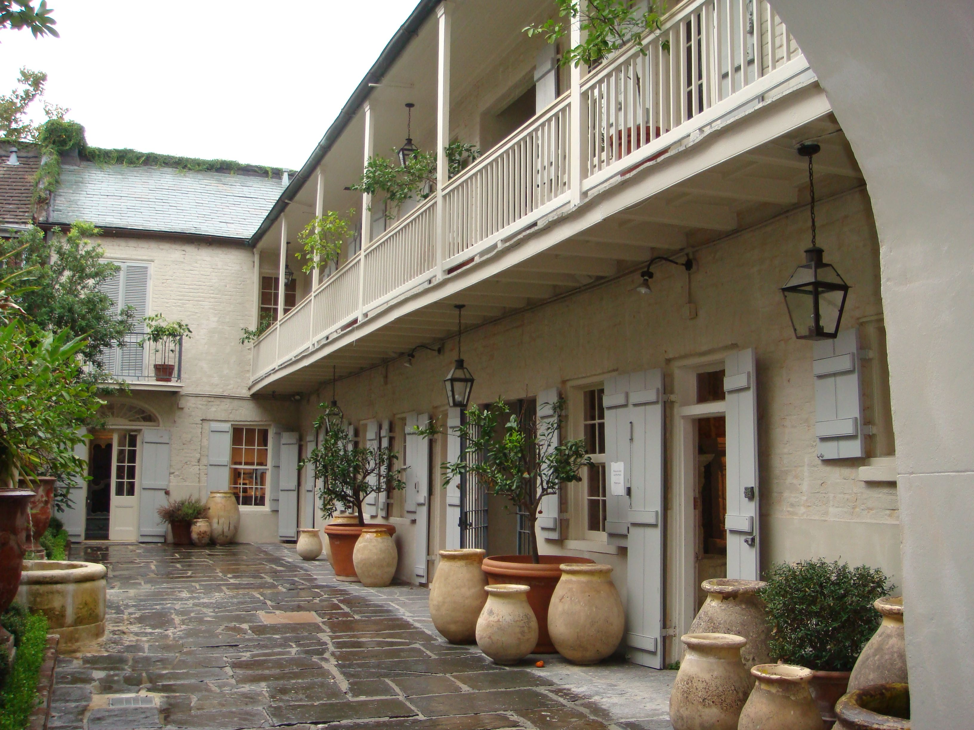 New Orleans courtyard. The yellowish pots are Olive Jars. Hays Town ...