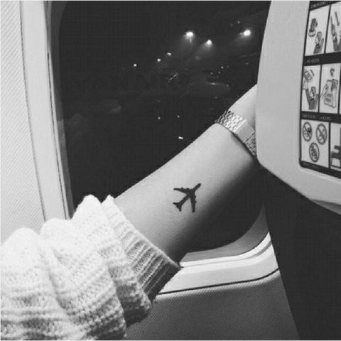 Small Tattoos for Women – Best Tattoo Designs for Women-Airplane-Let everyone know you're an insatiable traveller. Discover more creative tattoo designs at http://redbookmag.com.