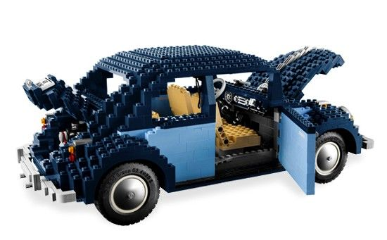 "Volkswagen 1960 -- [Lego's presents this 1960 VW Beetle. It comes in a box of 1,626 parts, so after hours of assembly you'll create a classic Bug. One good thing is that this vehicle will only cost you ""One Hundred Twenty Dollars""! When completed it measures 16 inches long by 6.5 inches tall. Its tiny stick shift moves, the glove compartment opens & the seats fold forward. The engine is in back where Beetle engines belong & up front is the spare tire.]'h4d'121106"