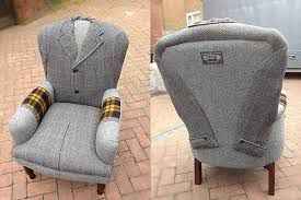 Chair upholstered with a tweed coat.
