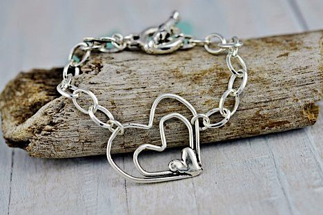 Full Heart BraceletTwo open hearts are anchored at the bottom by a third heart in this beautifully romantic silver bracelet with toggle closure. - See more at: http://www.islandcowgirl.com #hearts #heartnecklace #heartjewelry #inspirationaljewelry
