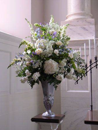 Elegant White And Blue Floral Arrangement For Church Setting