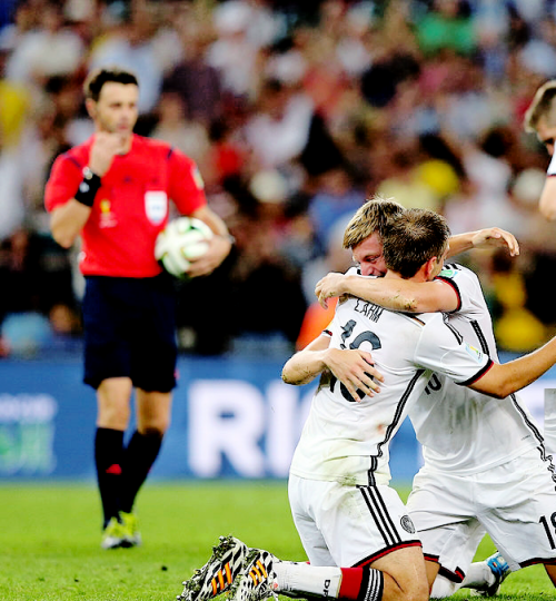 Toni Kroos and Philip Lahm hug tight celebrating the final match win. 13 July  Brazil WC 2014.