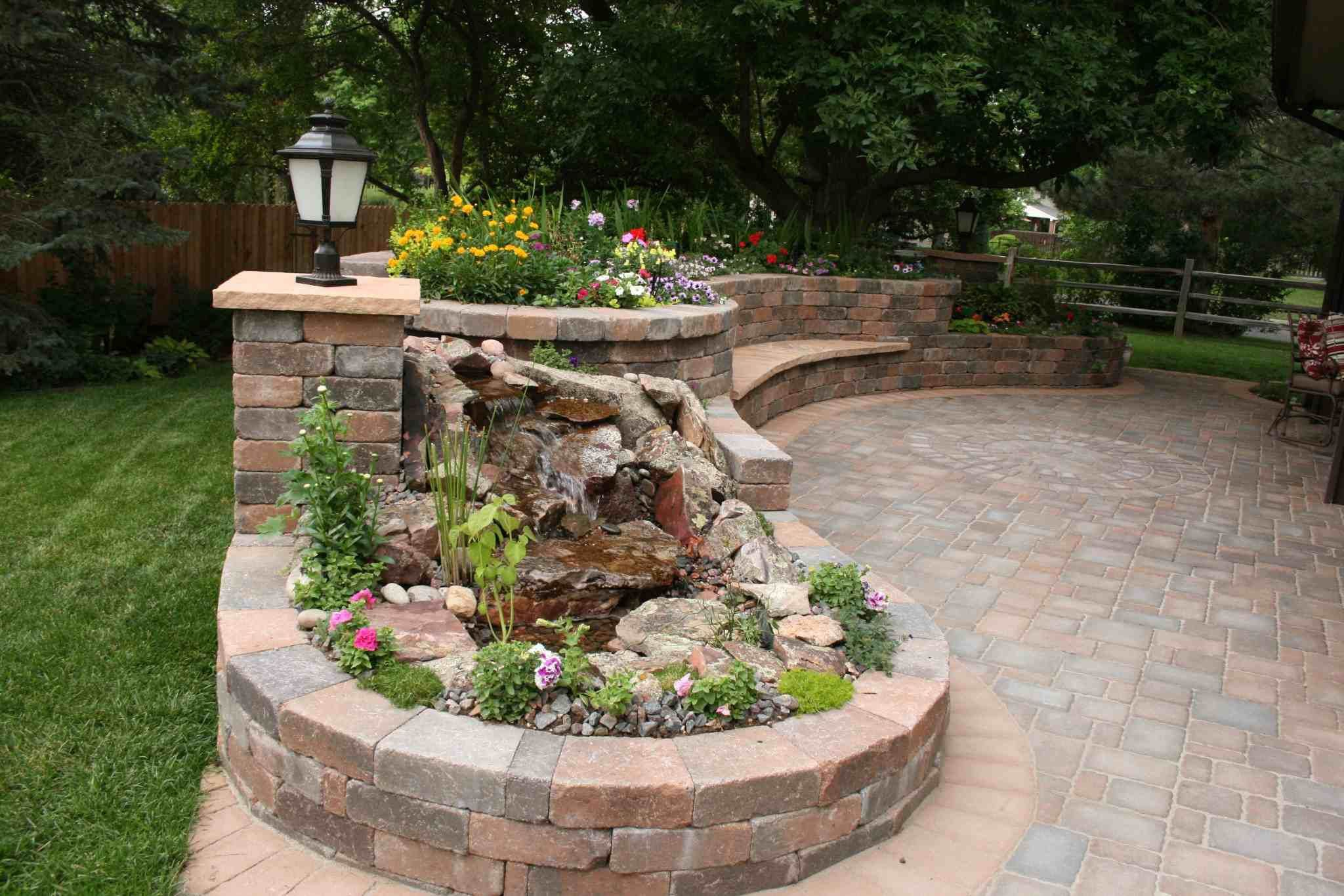 Garden fire features  Pondless contained water feature in patio