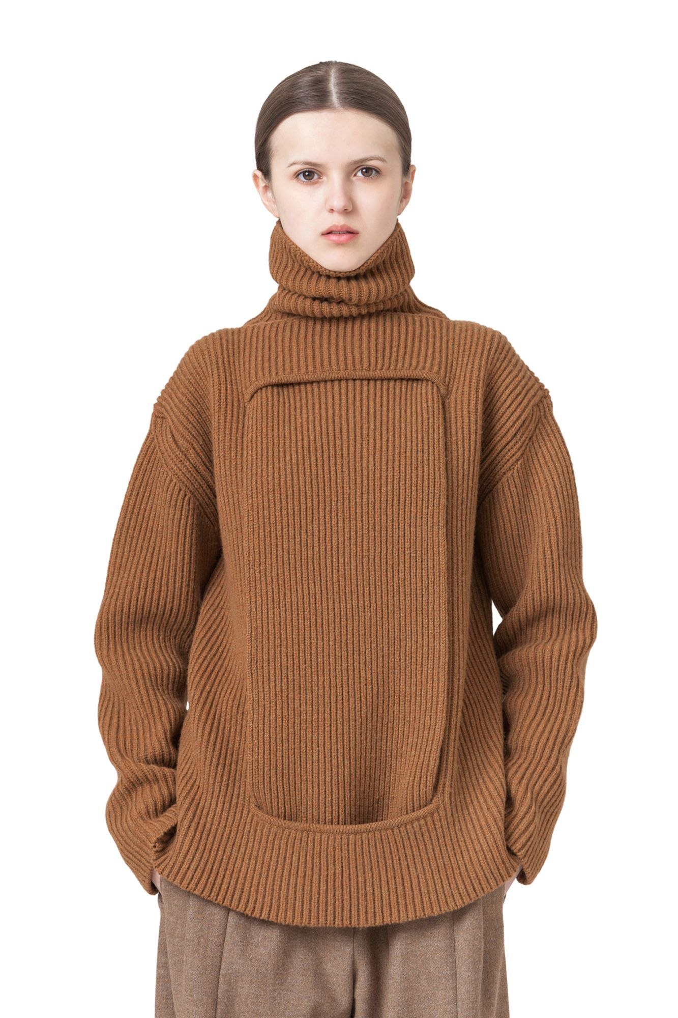 This extravagant pure merino wool piece can be worn on its own to reveal a hint…