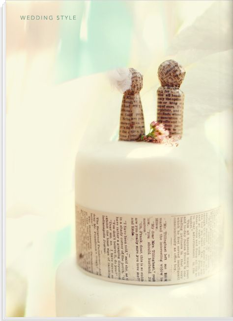 I love these little newspaper mached cake topper people!