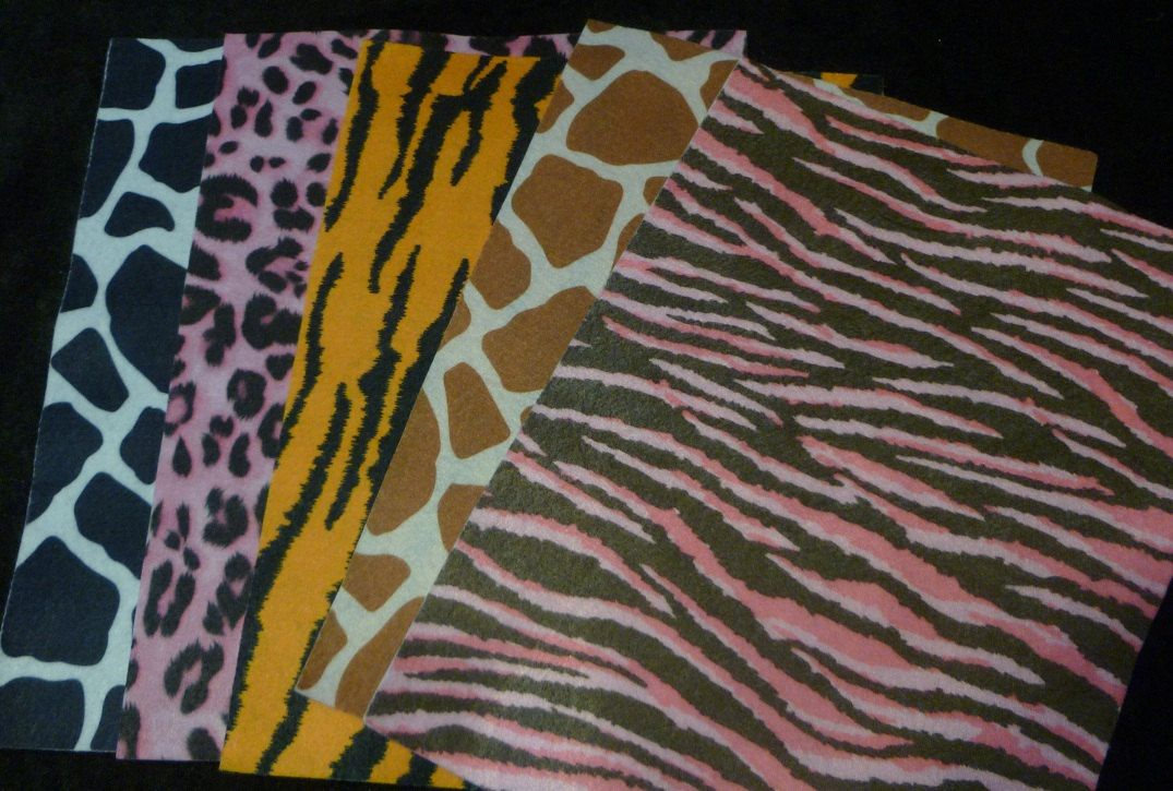 animal print felt sheets sew supplies / stripes tiger printed felt sheet / assorted sewing fabric 5 pieces. $7.50, via Etsy.