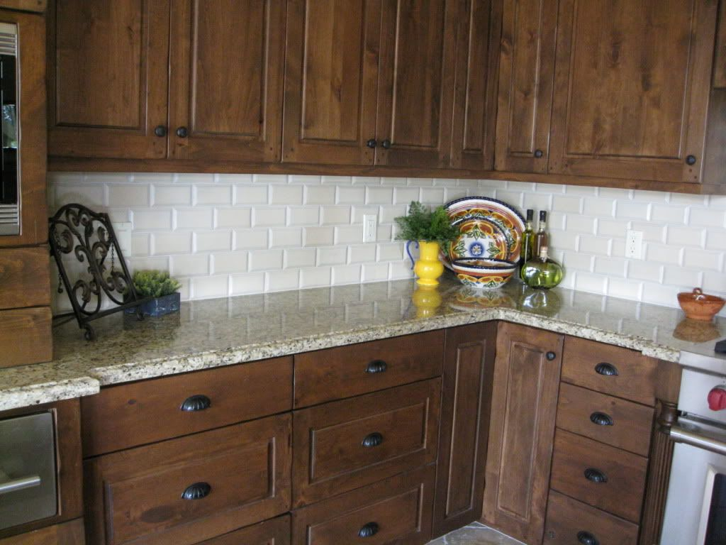 Venetian Gold Granite With A Cream Beveled Subway Tile