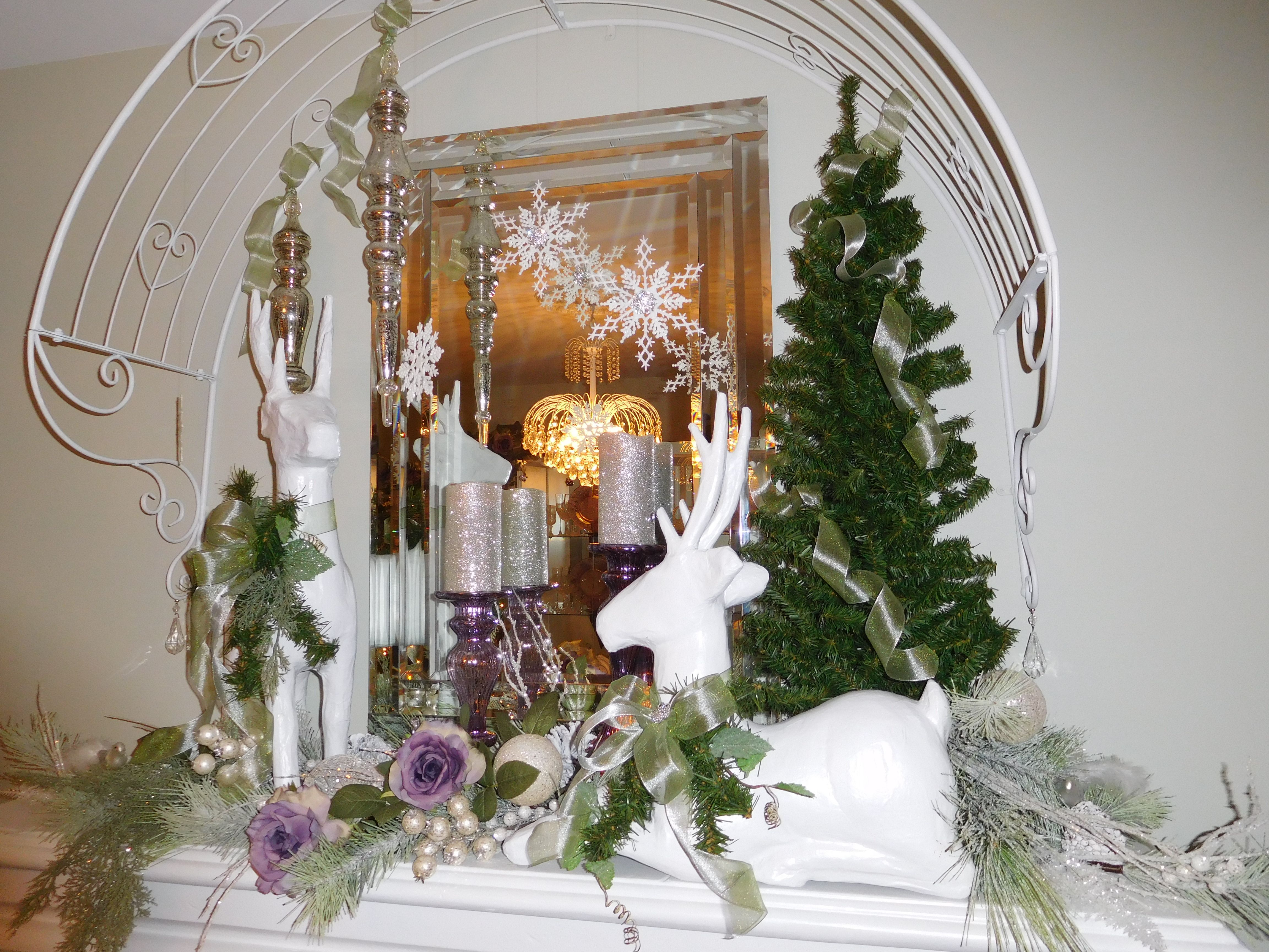 Christmas fireplace with deer and purple roses