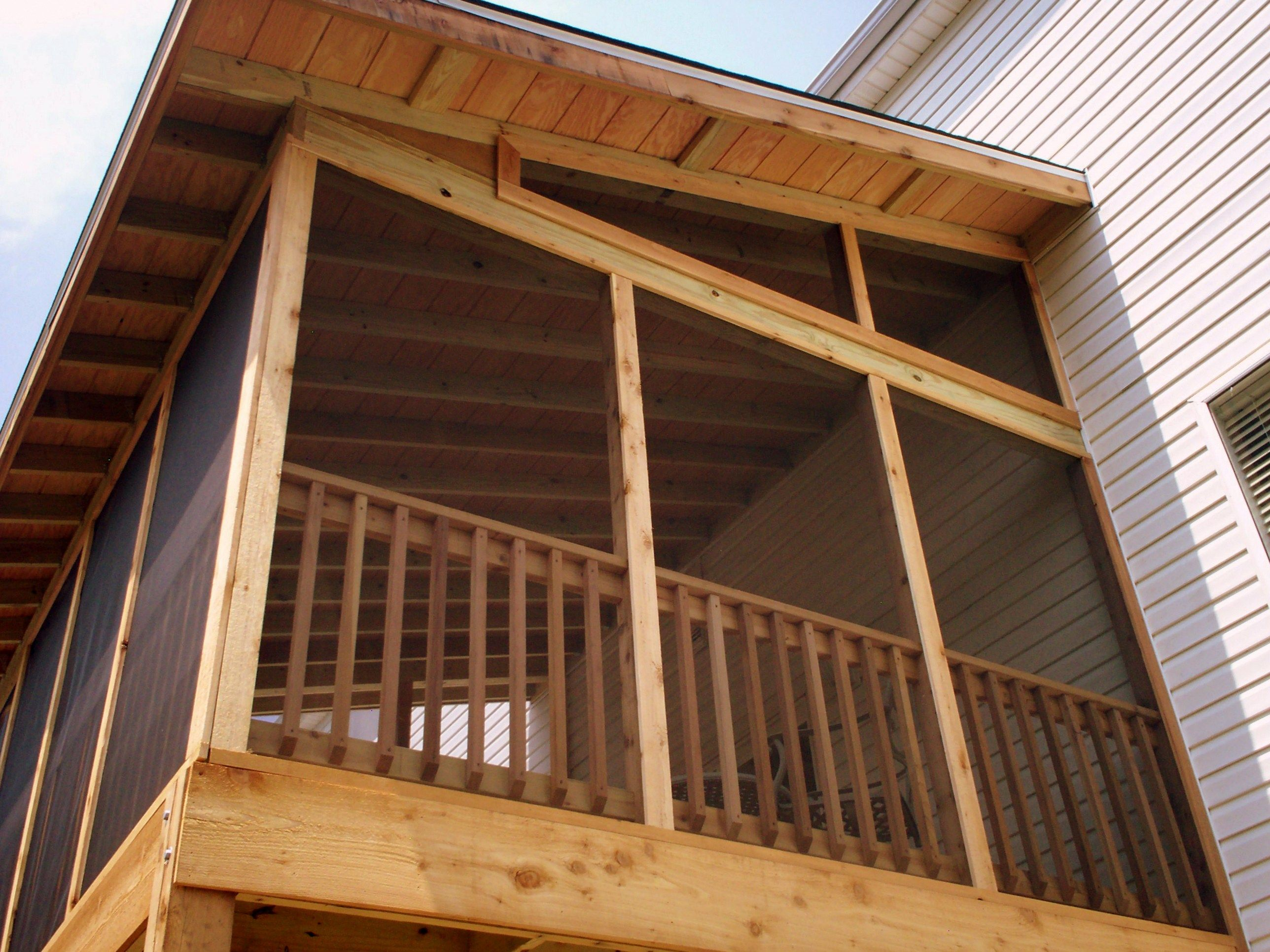 An elevated screened porch constructed with cedar creates for Shed roof screened porch plans