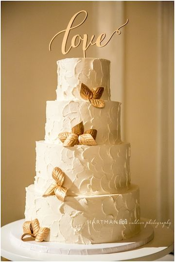 Homestyle Buttercream Wedding Cake With Gold Leaves And Gold Love Topper