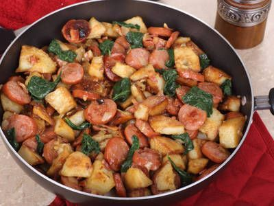 Photo of Sautéed smoked sausage with spinach, onions and potatoes. It…