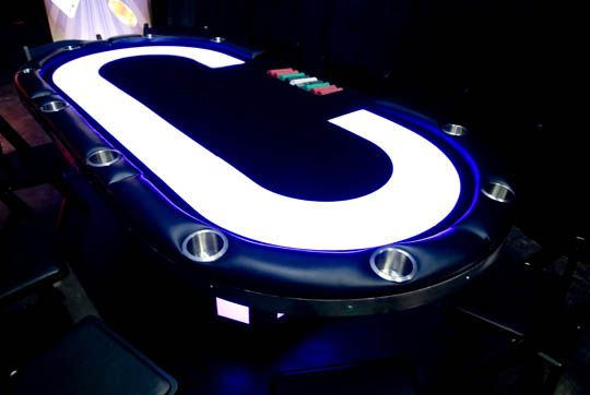 Poker table that lights up the game.   Poker table