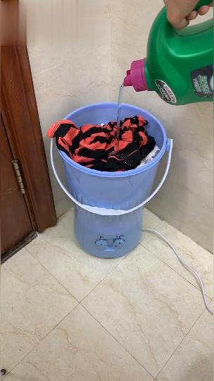 a Portable Mini Clothes Washing Machine That goes